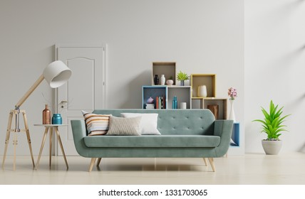 Living Room Interior with green sofa, pillows, lamp, shelves and vase with flowers on empty white wall.3D rendering