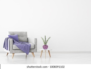 Living room interior with grey velvet armchair, violet plaid, vase and coffee table on empty white wall background. 3D rendering.