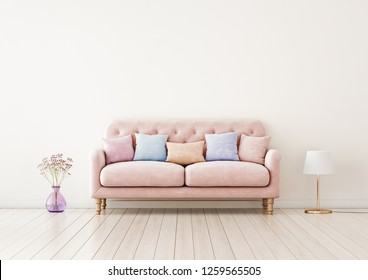 Living room interior wall mock up with pink tufted sofa, multi-colored pastel pillows, lamp and flowers in vase on neutral empty warm white background. Free space on top. 3D rendering.