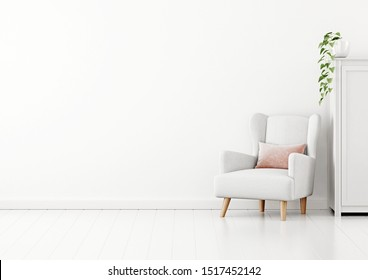 Living room interior wall mockup with white fabric armchair, pink pillow and green plant on the case on white wall background. 3D rendering, illustration.