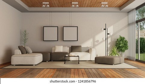 Living room in a modern villa with sofa, wooden ceiling and hardwood floor - 3d rendering