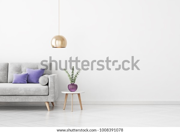 Livingroom interior wall mock up with grey velvet sofa, violet pillows, hanging lamp, vase and coffee table on empty white background. 3D rendering.