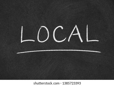 local concept word on a blackboard background