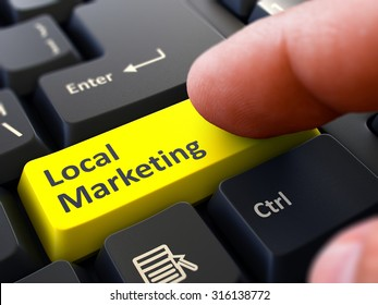 Local Marketing Button. Male Finger Clicks on Yellow Button on Black Keyboard. Closeup View. Blurred Background.