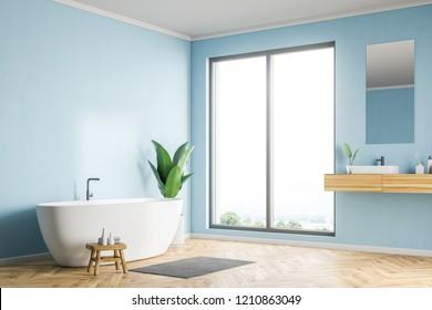 Loft bathroom corner with blue walls, wooden floor, white bathtub and sink with vertical mirror. 3d rendering