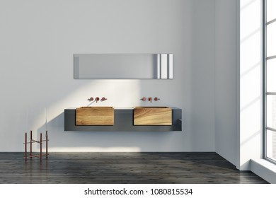 Loft bathroom interior with white walls, and a wooden double sink with a narrow horizontal mirror hanging above it. 3d rendering