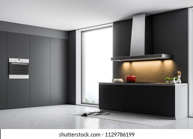 Loft kitchen interior with dark gray walls, a concrete floor, and countertops with built in appliances. A side view. 3d rendering mock up