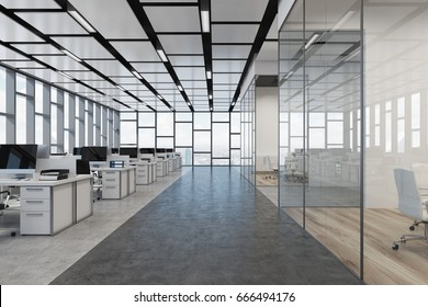 Loft open space office interior with rows of computer tables with desktops standing on them, glass walls. 3d rendering