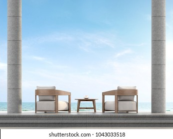 Loft terrace with sea view 3d render,The terrace has  floor and stair are concrete tile and columns are polished concrete,Furnished  with fabric armchair and overlooking the sea.