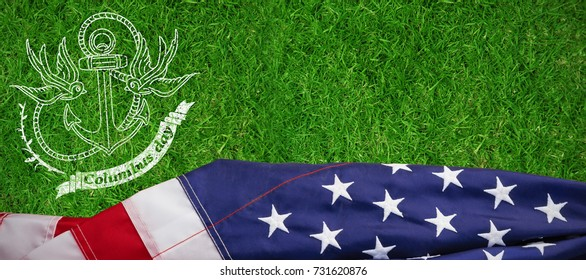 Logo for american event colombus day against closed up view of grass