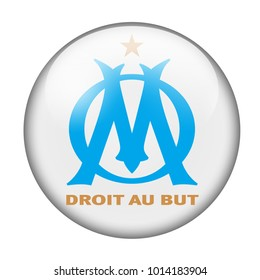 LONDON / ENGLAND - October 24, 2012: FC Olympique de Marseille logo on glossy button. Isolated on white backgound