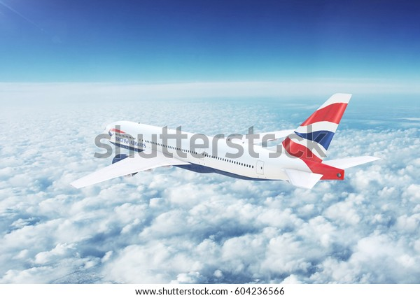 LONDON, UK - CIRCA 2017: In-flight view of British Airways Boeing 777 Commercial Passenger Aircraft Flying High Up in the Sky Above the Clouds. 3D Illustration.