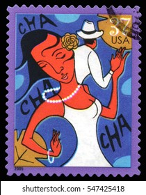 London, UK, July 30 2014 - Vintage 2005 United States of America cancelled postage stamp showing an abstract image of a couple dancing the Cha Cha
