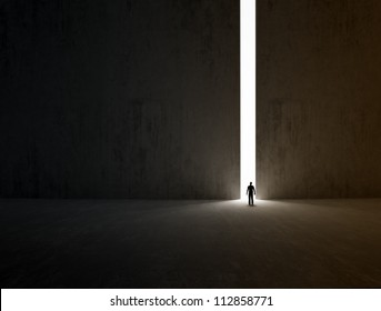 A lonely person walking through a narrow passage