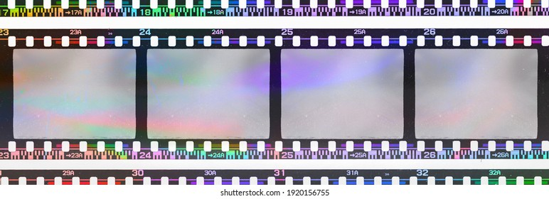 long 35mm negative film strip with empty or blank frames and strange scanning light interferences on the material.