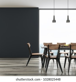 Long black dining room table with black and wooden chairs standing in a black room. A large window and a blank wall fragment. 3d rendering mock up