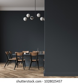Long black dining room table with black and wooden chairs standing in a black room. A blank wall fragment. 3d rendering mock up