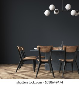 Long black dining room table with black and wooden chairs standing in a black room. 3d rendering mock up close up