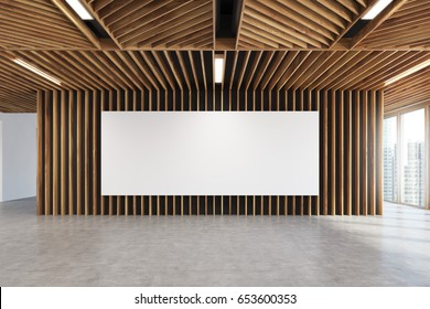Long horizontal poster is hanging on a light wooden wall of a modern office or an art gallery. Panoramic windows. 3d rendering mock up