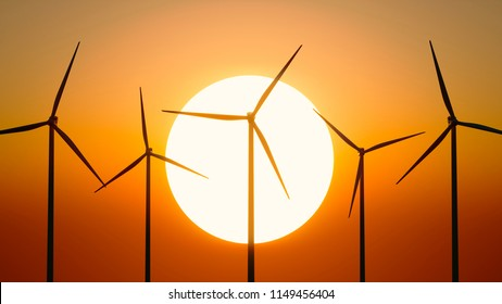Looking into the sunrise wind energy production in california in the foreground 3d illustration red sky