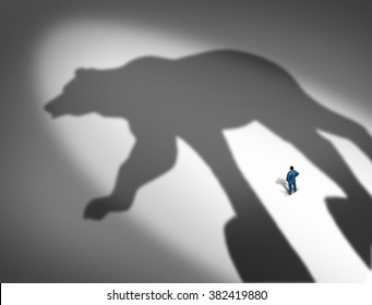 Looming financial crisis and slumping stock market business concept as a businessman standing in front of the cast shadow of a bear as a loss and price decline metaphor.