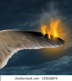 Lost liberty and losing freedom concept as the feathers of a bird wing is burning in flames as a political or social concept of the dangers and struggle of the human right to be free.