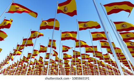 Lots of Spain flags fluttering in the wind against blue sky. Three dimensional rendering 3D illustration.