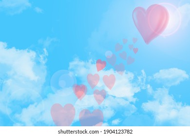 Love is in the air,  with clouds and blue background.