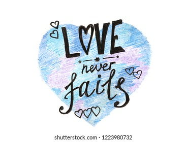 Love never fails - painting text on blue heart shape isolated on white, valentines day card