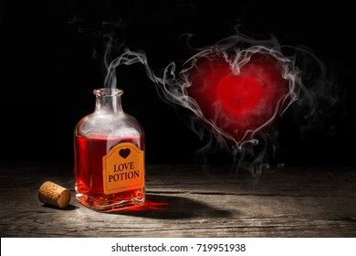 Love potion is red in a bottle. The fragrance of the elixir evaporates and draws from the smoke a heart symbol. Valentine's Day. 3D rendering