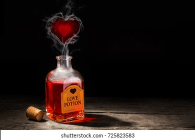 Love potion is red in a bottle. The fragrance of the elixir evaporates and draws from the smoke a heart symbol. Valentine's Day. Copy space for text. 3D rendering