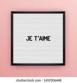 Love quote on square white letterboard with black plastic letters. Hipster vintage inspirational poster 80x, 90x. Je taime