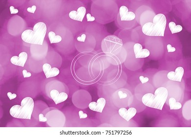 love and relationships conceptual illustration: wedding rings surrounded by lovehearts on pink bokeh background