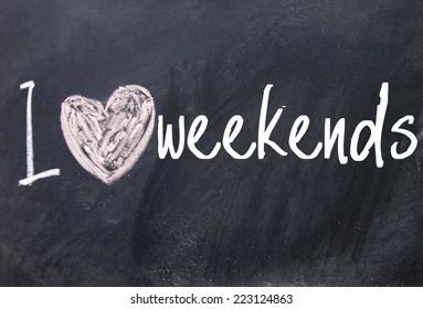 I love weekends text on blackboard