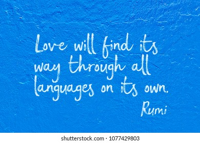 Love will find its way through all languages on its own - ancient Persian poet and philosopher Rumi quote handwritten on blue wall