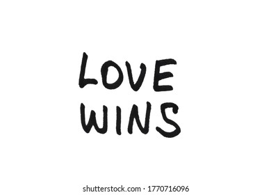 Love wins! Handwritten message on a white background.