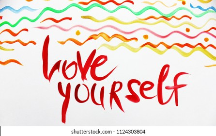 Love yourself. Colorful creative background. Art background. The message, note, advice, quote, motivation, rules of life. Handwritting text, expression. Cover design, calligraphy, card, lettering.