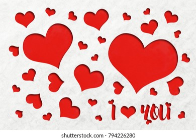 Lovely red heart shape background cuts out of an off white grain paper inspired a theme of LOVE with I LOVE YOU message.