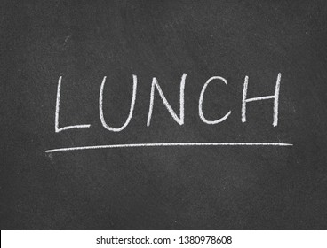 lunch concept word on a blackboard background