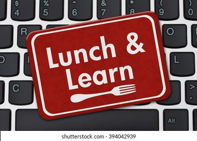 Lunch and Learn Sign, A red hanging sign with text Lunch and Learn and a fork on a keyboard