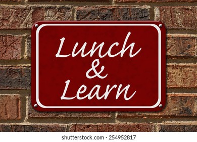 Lunch and Learn Sign,  A red sign with the word Lunch and Learn on a brick wall