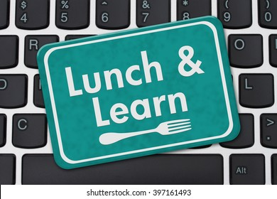 Lunch and Learn Sign, A teal hanging sign with text Lunch and Learn and a fork on a keyboard