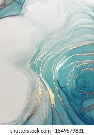 Luxury abstract fluid art painting background alcohol ink technique turquoise and gold