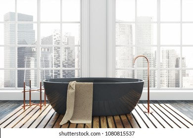 Luxury bathroom interior with a dark wooden floor, white walls, and a black bathtub. A beautiful cityscape seen through the windows. 3d rendering