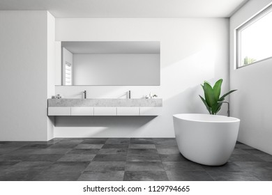 Luxury bathroom interior with white walls, a tiled black floor, a white bathtub, a shower and a double sink. A narrow horizontal window. Scandinavian style. Side view. 3d rendering