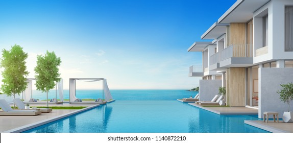 Luxury beach house with sea view swimming pool and terrace in modern design, Lounge chairs on wooden floor deck at vacation home or hotel. - 3d illustration of contemporary holiday villa exterior.