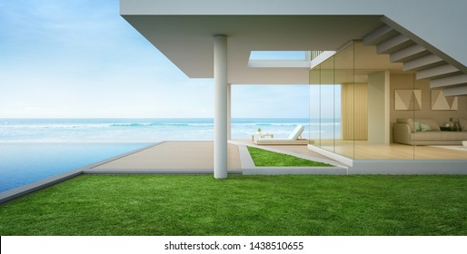 Luxury beach house with sea view swimming pool and terrace in modern design. Empty wooden floor deck at vacation home or hotel. 3d illustration of contemporary holiday villa exterior.