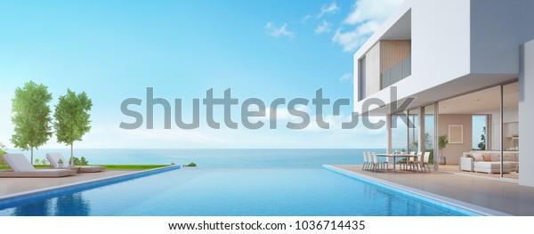 Роскошный дом на пляже с видом на море бассейн и терраса в современном дизайне, шезлонги на деревянной палубе в доме отдыха или отеле - 3d иллюстрация современного отдыха экстерьера виллы