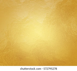 luxury gold background with crinkled foil texture and light center and brown border, old elegant yellow paper