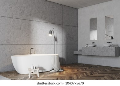 Luxury gray bathroom interior idea. A wooden floor, a double sink and a white bathtub. Large gray tiled walls. A side view. 3d rendering mock up